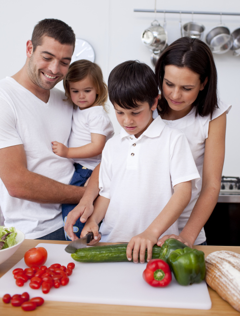 bigstock-cheerful-family-cooking-togeth-13705145